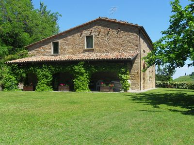 Photo for Stone house in the green rolling hills of the Apennines with garden.