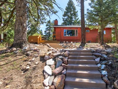 Photo for Warm and cozy cabin w/ modern comforts, hot tub, spa, and a great location!