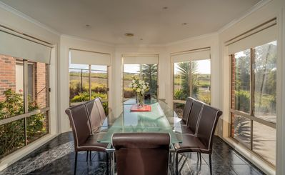 Dining Room w/ beautiful views of the paddock Kangaroos can be seen in evenings