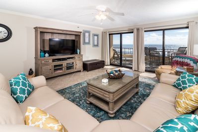 Spacious family room with views that will take your breath away. - The living area is a great place for entertaining or relaxing. Glass doors lead directly to the 30' private balcony overlooking the beach.