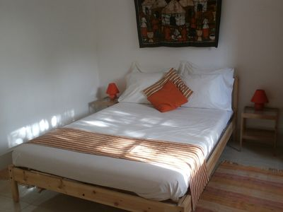 Photo for Nice room with double bed at poolside in a tropical garden.