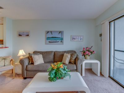 Photo for Swimming pools, shuffleboard, tennis, steps to the beach! Snowbirds welcome!