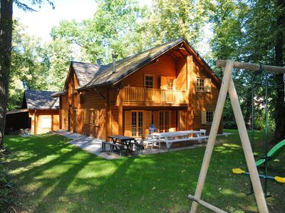Photo for Spacious chalet located at Bomal with jacuzzi and garden parlour
