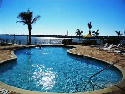 Heated pool and hot tub overlooking bay