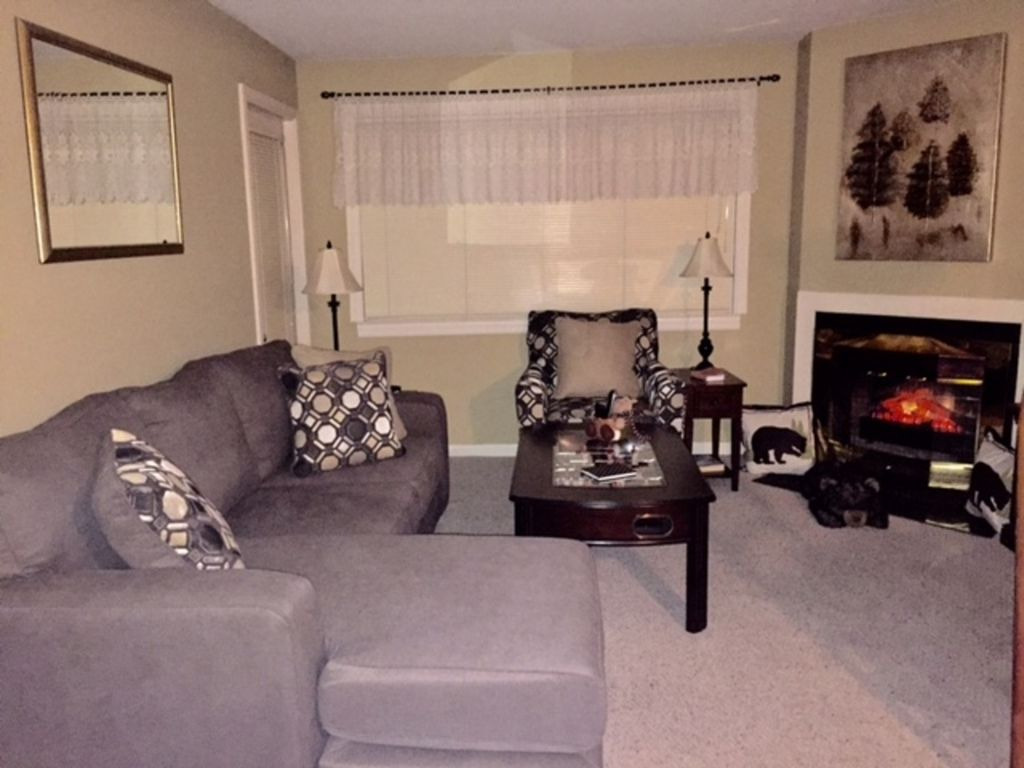 Newly Remodeled Living Room With Nice Comfy Sofa, Chair, And Foosball Table