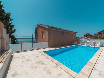 Photo for Spacious holiday home with private, heatable pool, big terrace, 70m from the sea