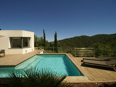Photo for Modern, detached villa, quietly located near golf course and close to the sea