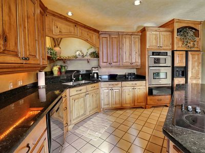 Photo for Amazing 5 Star  4 Bed/4 bath, Private Hot Tub, ,Theater,Game Table