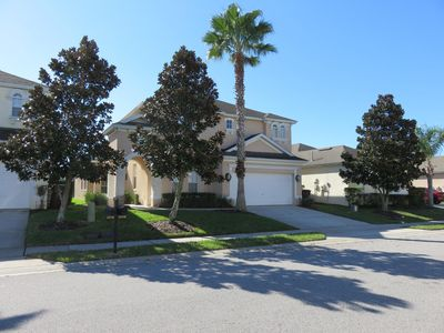 Photo for Luxury 5 bed Villa with south facing pool. 24 hour gated community near Disney