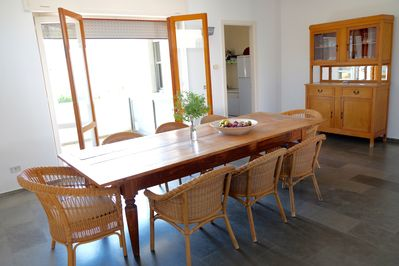 spacious dining room with separate kitchen