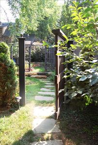 A stone path winding through the Studio's garden leads to its private entrance.