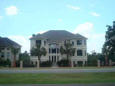 5 Bedroom / 5.5 baths.  Front views a golf course & rear views Savannah river.