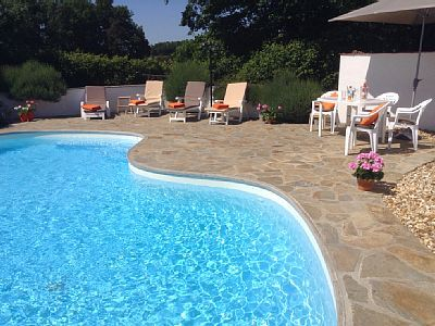 Secluded swimming pool 8x4m with sun loungers, table and chairs.