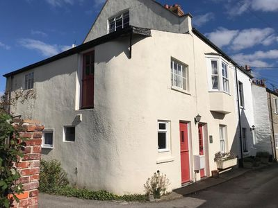 Photo for Secluded character cottage in the very heart of Bridport