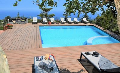 Photo for Beautiful villa surrounded by palm trees and gardens with sea views, a wide terrace and a large pool