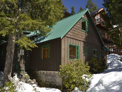 Photo for Heart of village!  Stone fireplace, knotty pine interior, a real cabin!