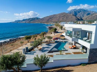 Photo for Sea front 9 bedroom villa with infinity pool, jacuzzi, hot tub &  views