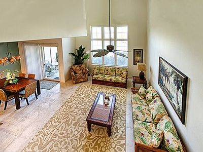 Elegance; 18' ceilings w/10' of windows to tropical beauty; sofa has queen bed