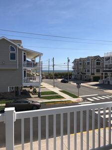 Photo for Beachblock Nice large deck for sunning. Ocean views. Just steps to the beach and promenade. Wireless Internet Included.