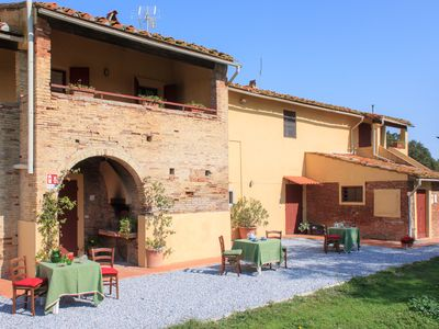 Photo for Magnificent apartment in the Tuscan countryside with swimming pool