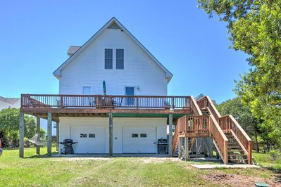 This vacation rental home has 4 bedrooms, 2.5 bathrooms, and sleeps 11!