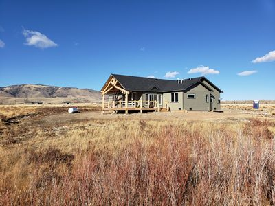 Photo for New 4 bedroom 2 1/2 bath house on 5 acres with stunning view of Centennial Ridge