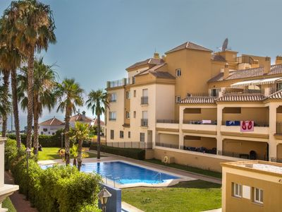 Photo for Central Apartment on the Beach with Terrace, Pool, Garden, Tennis Court, Air Conditioning & Wi-Fi