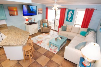 Bright and inviting w/tropical colors, comfortable seating and open floor plan!
