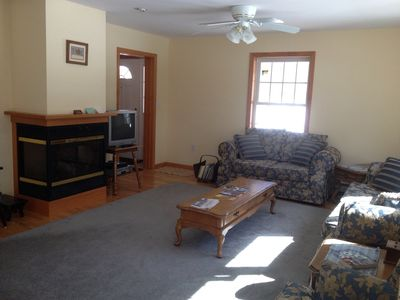 Comfortable living room with gas fireplace and satelite tv.