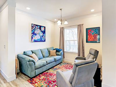 Sitting Room - An additional sitting area has a couch and 2 armchairs.