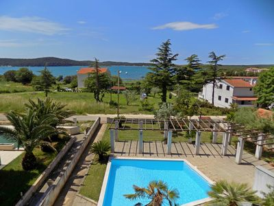 Photo for Holiday apartment with pool, air conditioning and sea view