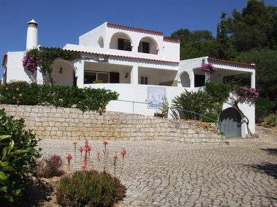 Photo for Great Location,HEATED, Gated Pool, Walk to town and Beach.  Amazing views