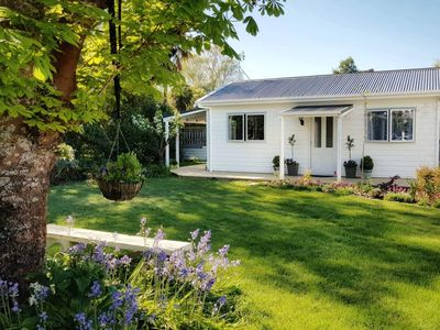 Photo for 1 bedroom, sc cottage in private garden setting, comfortable, modern,