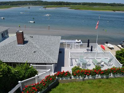 Photo for Sunset Cottage: Direct waterfront with two decks on the Annisquam River.