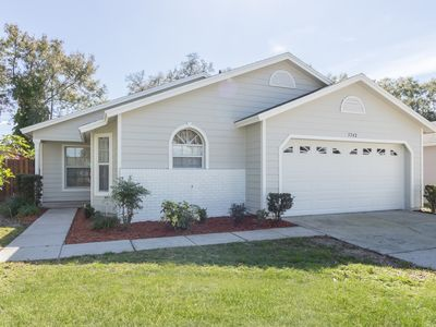 Photo for Completely renovated, very private 4 bed / 2 bath home 10 minutes from Disney!