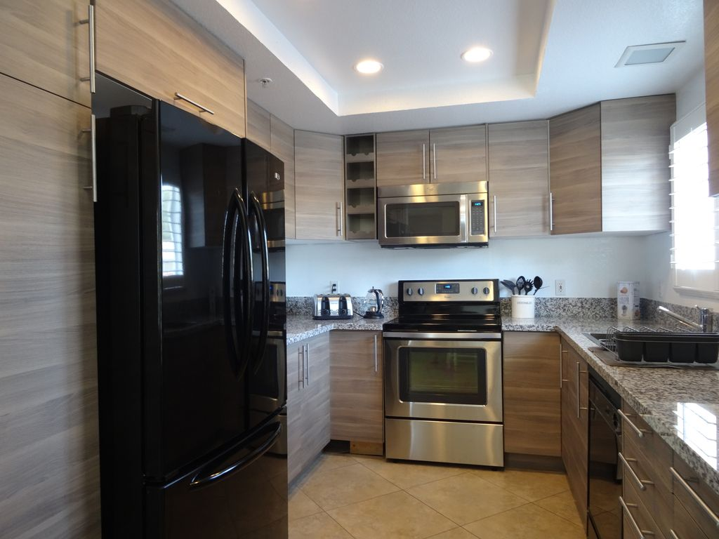 Brand New Kitchen With Granite Counter Top And Stainless Appliances