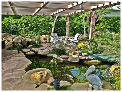 Patio view of the koi pond and water fall. One of the many spaces to relax.