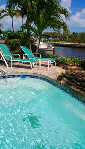 Photo for Waterfront, boatlift, easy ocean access, heated pool, walk to beach!