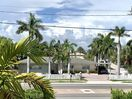 SeaBreeze House is  surrounded by Royal Palm Trees on a corner lot