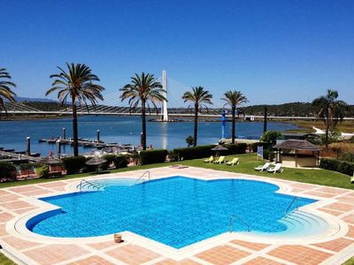 Photo for apartment panoramic view of the pool, and the arade river Lagoa, Algarve