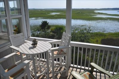 Two screened decks offer this peaceful endless view over the waterway and marsh