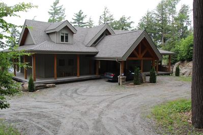 Covered carport and porch surrounding cottage