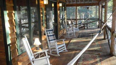 Wrap around porch with view, rocking chairs and hammocks
