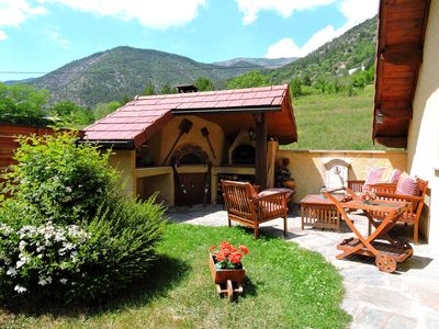 Photo for Promo: From 29/9 to 19/10 = 309 € / week / cottage at the edge of the lake ponçon / randos / fishing ..