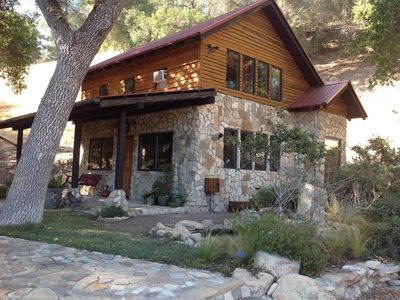Photo for Rustic, Tranquil Stone Cabin Under the Oak Trees