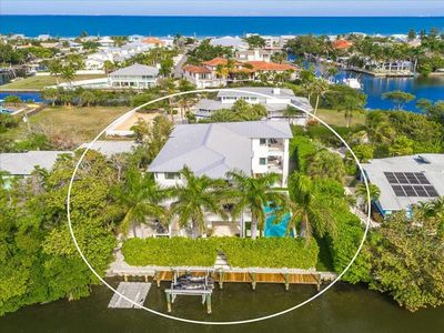 Photo for Spacious, luxury, canal front pool home in the center of Anna Maria city.