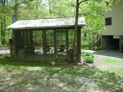 Old camp/screened in building with working fireplace--great for rainy nights.