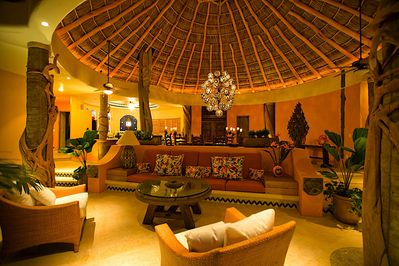 Impressive open living area under a huge palapa