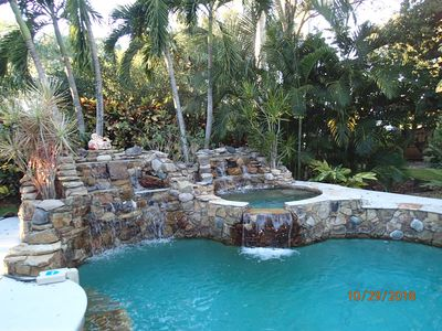 Photo for Gorgeous Tropical Home w/ Twin Falls Pool & Spa & 15 min to Beautiful Beaches
