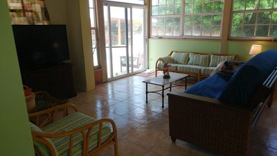 living room of cottage facing out to pool